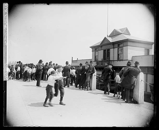 People Gathered Outside The Free Public Baths At The Battery, New York City, 1890.