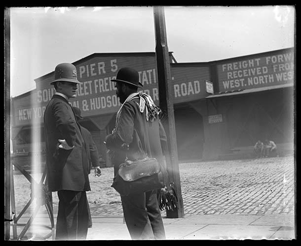 Police Office And Suspender Peddler Talking In Front Of Pier 5, New York City, 1898.