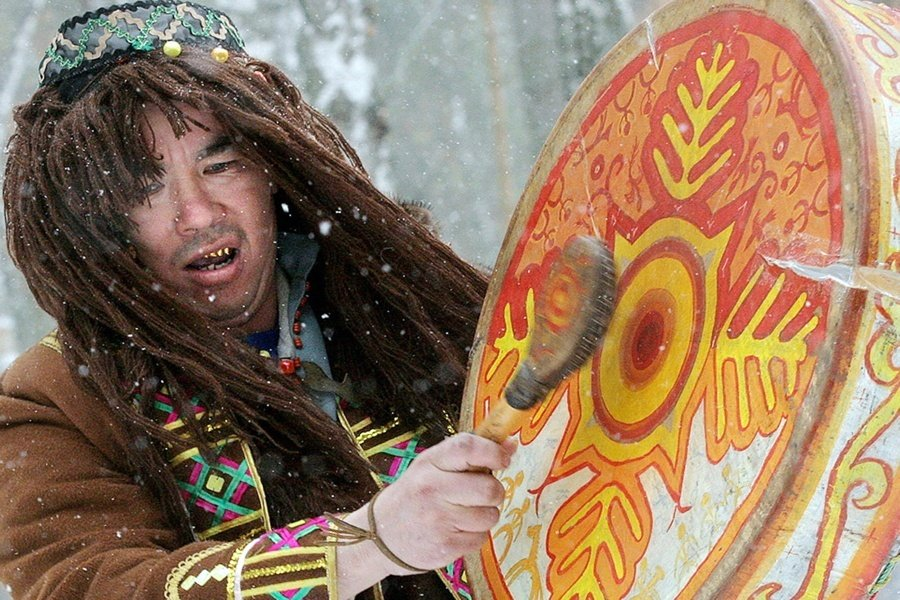 Shaman Beating Drum