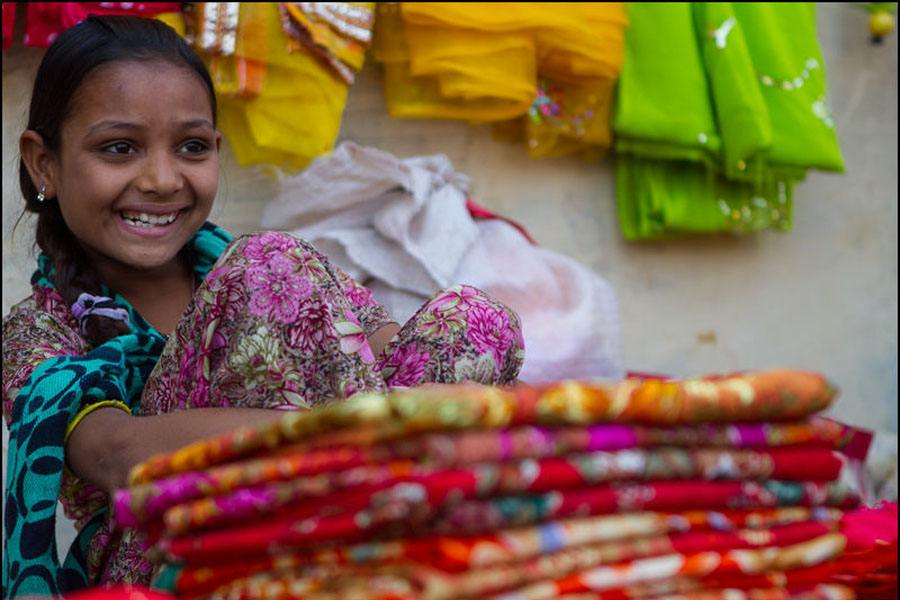Girl Smiles In Marketplace