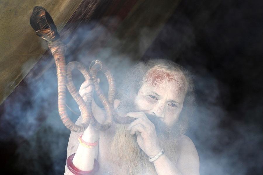 Man Smoking Long Pipe