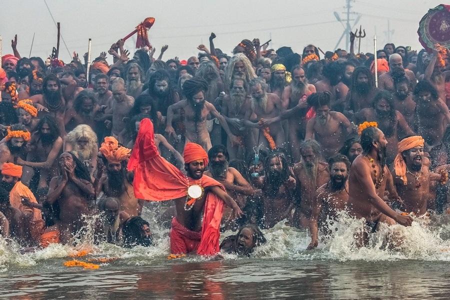 Men Running Into Water