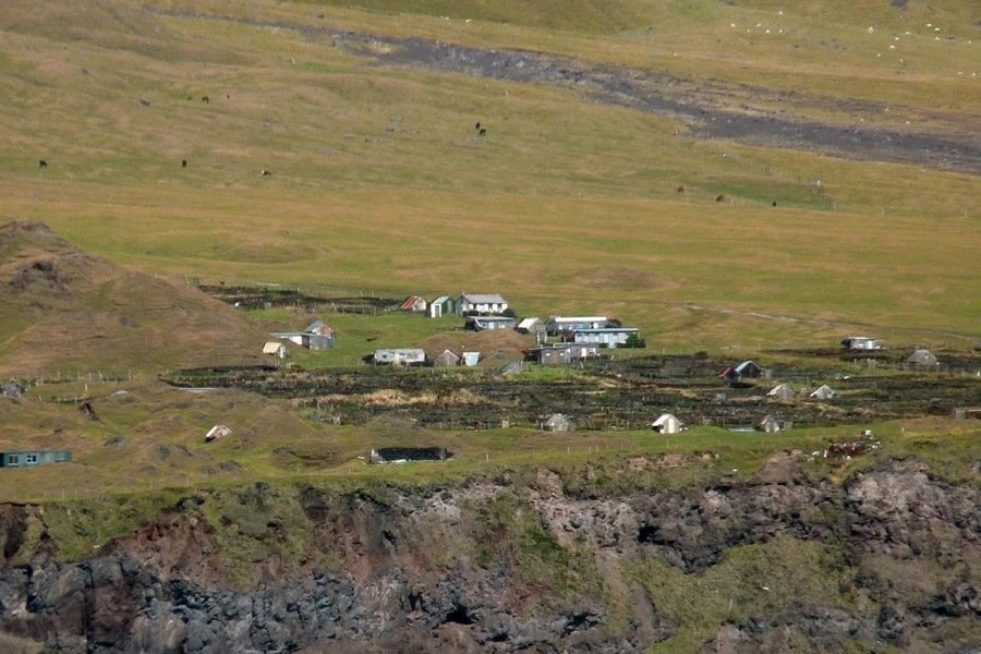 Small Buildings Rock Cliffs
