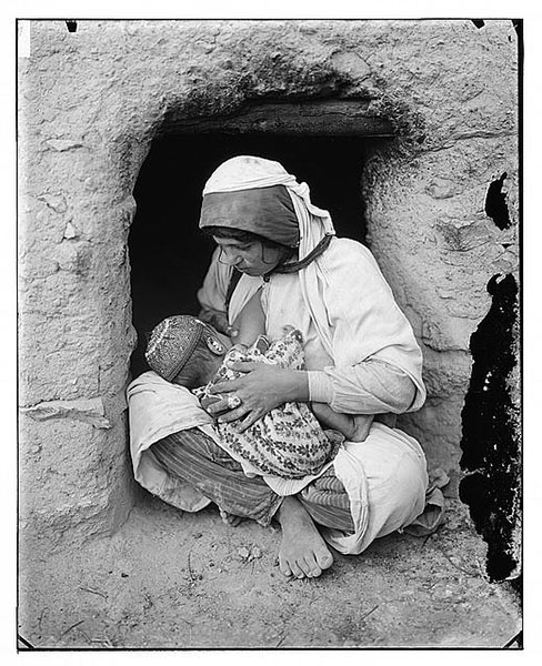 Syrian Woman Nursing Baby.