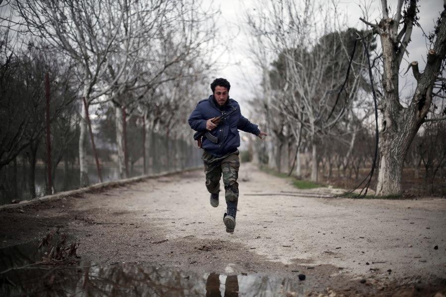 Man Running With Gun