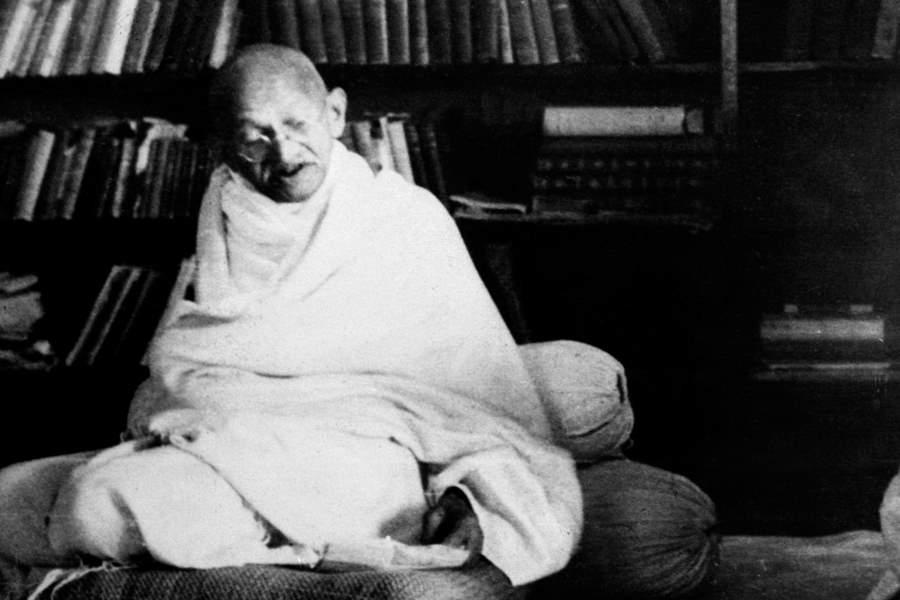 Gandhi Sitting On A Cushion