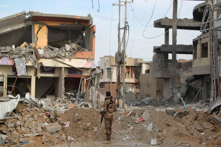 Soldier Standing Amid Rubble
