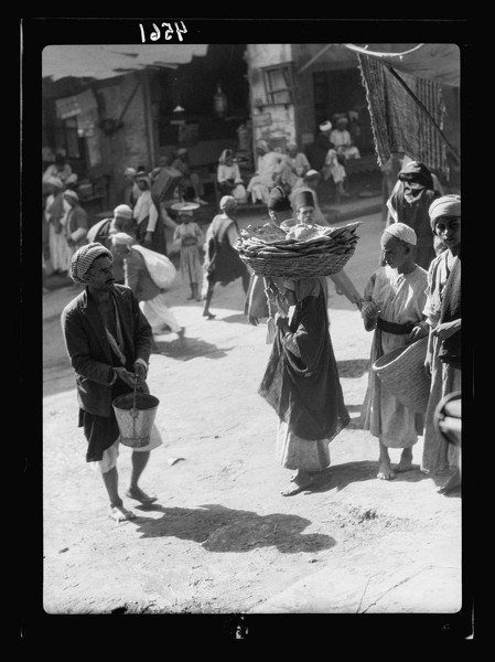 Woman Carrying Basket