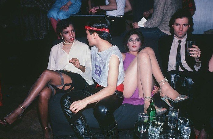 Four People Chatting With Garters