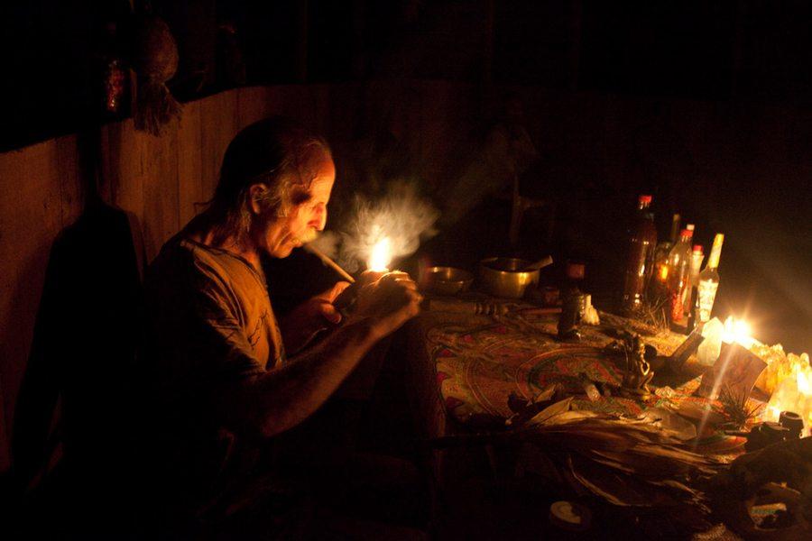 Man Smoking Near Candles