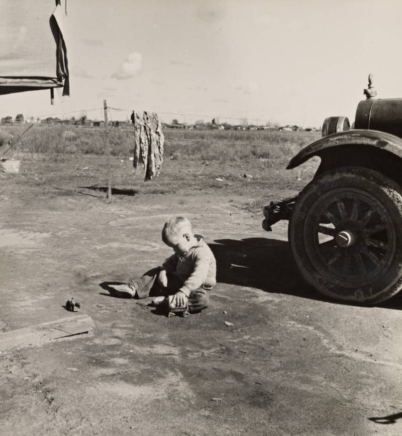 Child Sitting On Ground