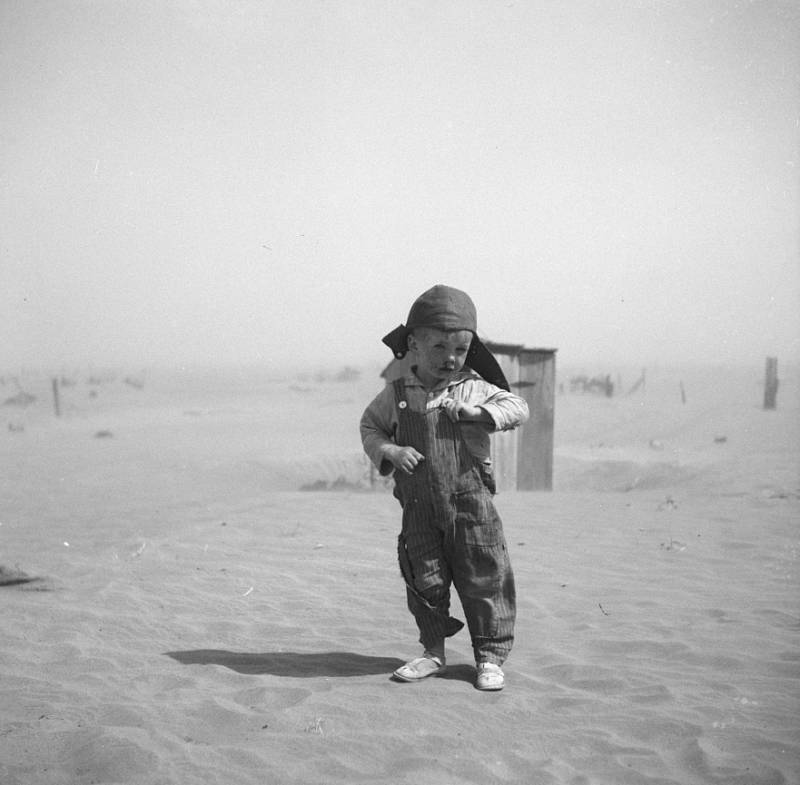 Child Walking In Dust