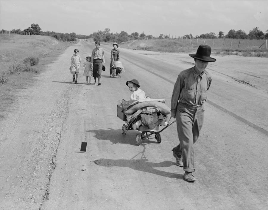Family Walking Down Road