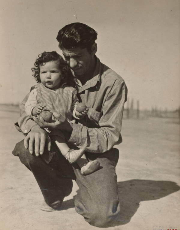 Man Kneeling Holding Child