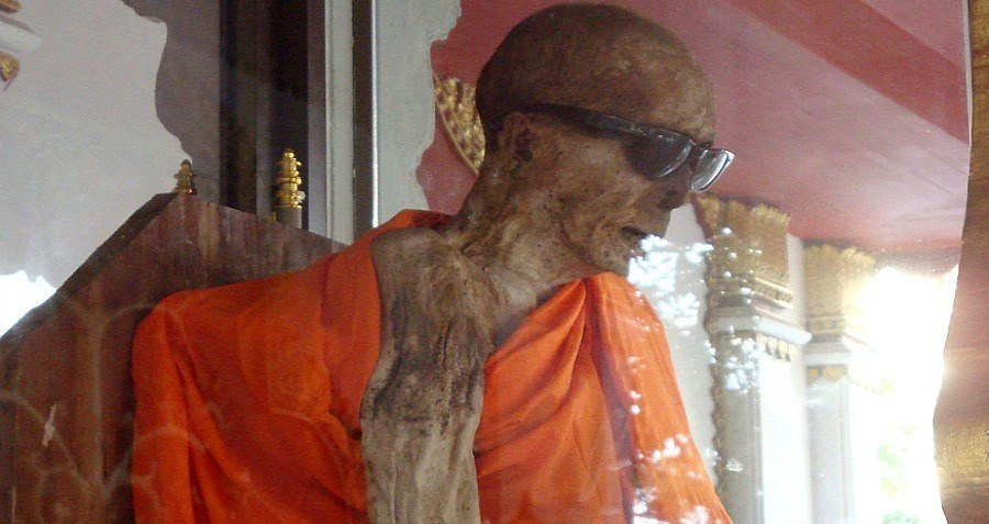 Mumified Monk In Orange Robe With Sunglasses