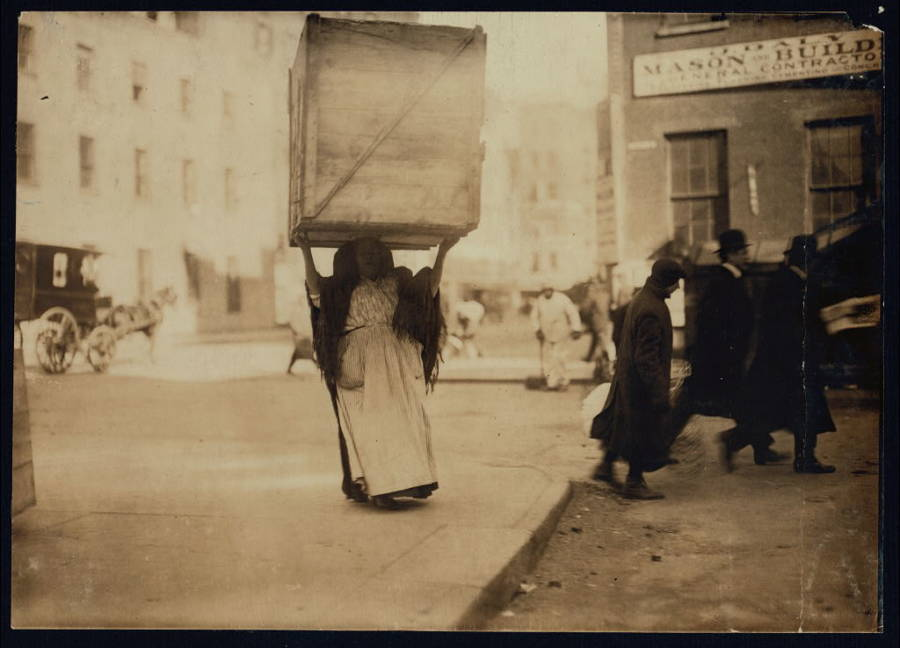 Woman Carrying Box