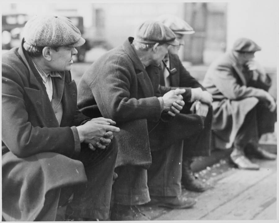Men At Docks