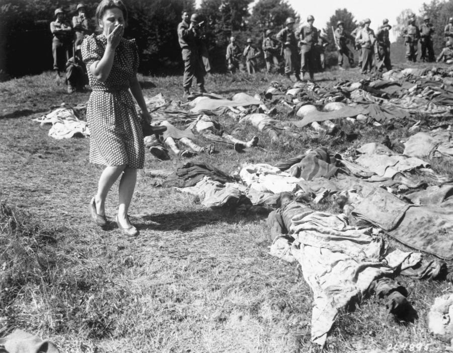 Woman Walking By Bodies