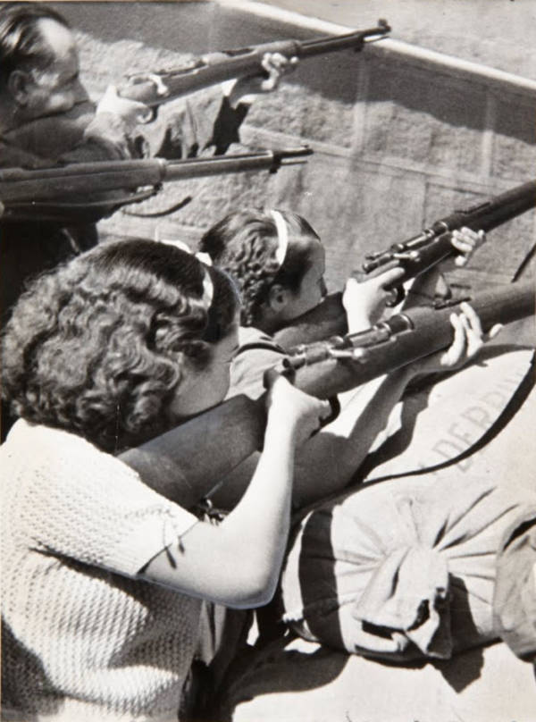 Women Pointing Rifles