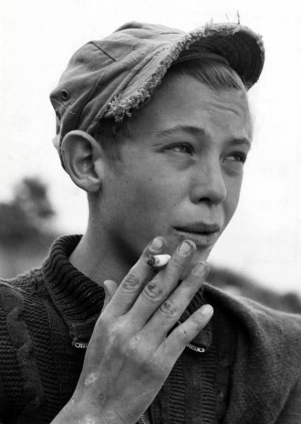 Smoking Boy At A Playground