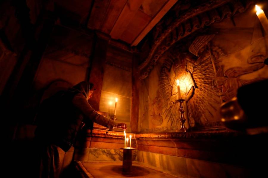 Praying At The Tomb Of Jesus