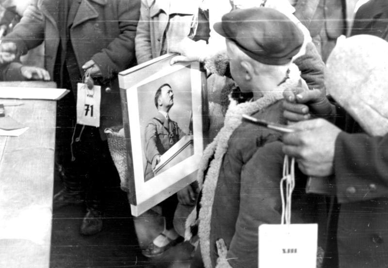 Kid Holding Hitler Photo