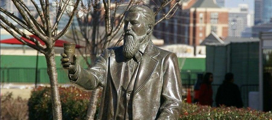 Statue John Pemberton Holding Drink Coca Cola