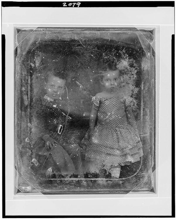 Two Unidentified Children Seated