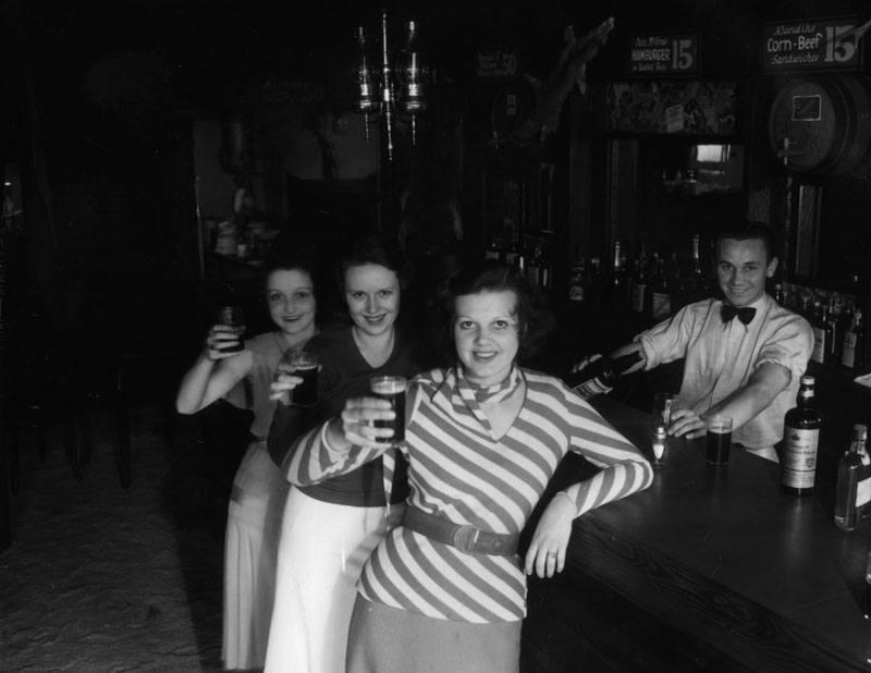 Malamute Saloon Girls Drinking