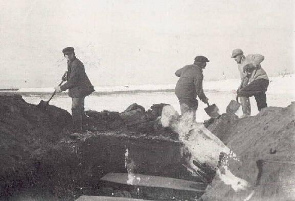 Men Burying Victims Of The 1918 Flu Pandemic