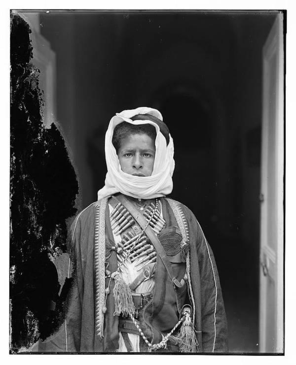 Bedouin Boy With Cartridges