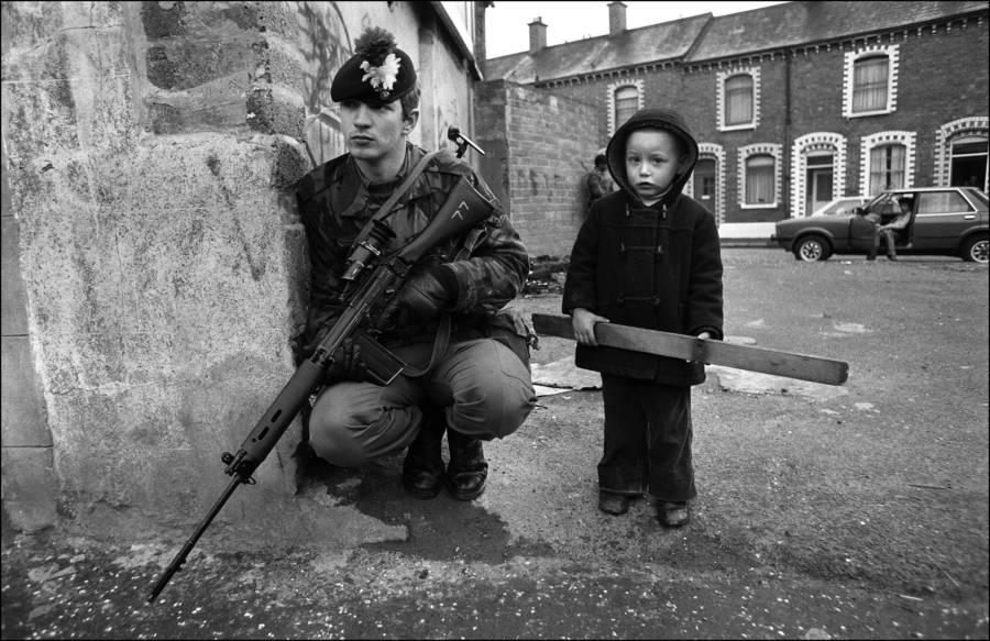 Child Near Armed Man