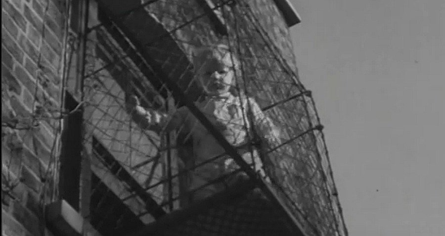Child Standing In A Baby Cage