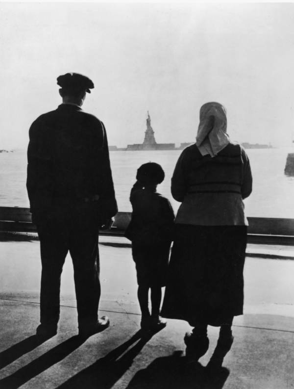 Ellis Island Immigrants Look At The Statue Of Liberty