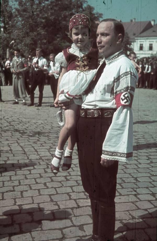 Man Holding Girl Swastika