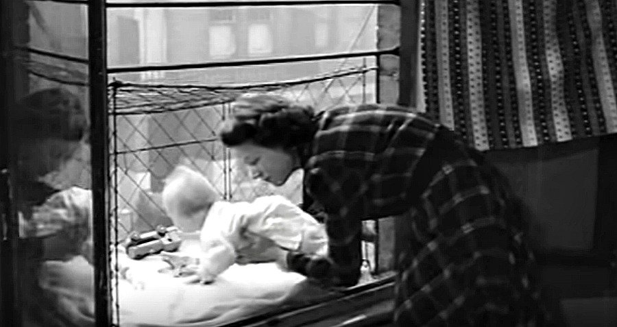 Mother Placing Baby Cage