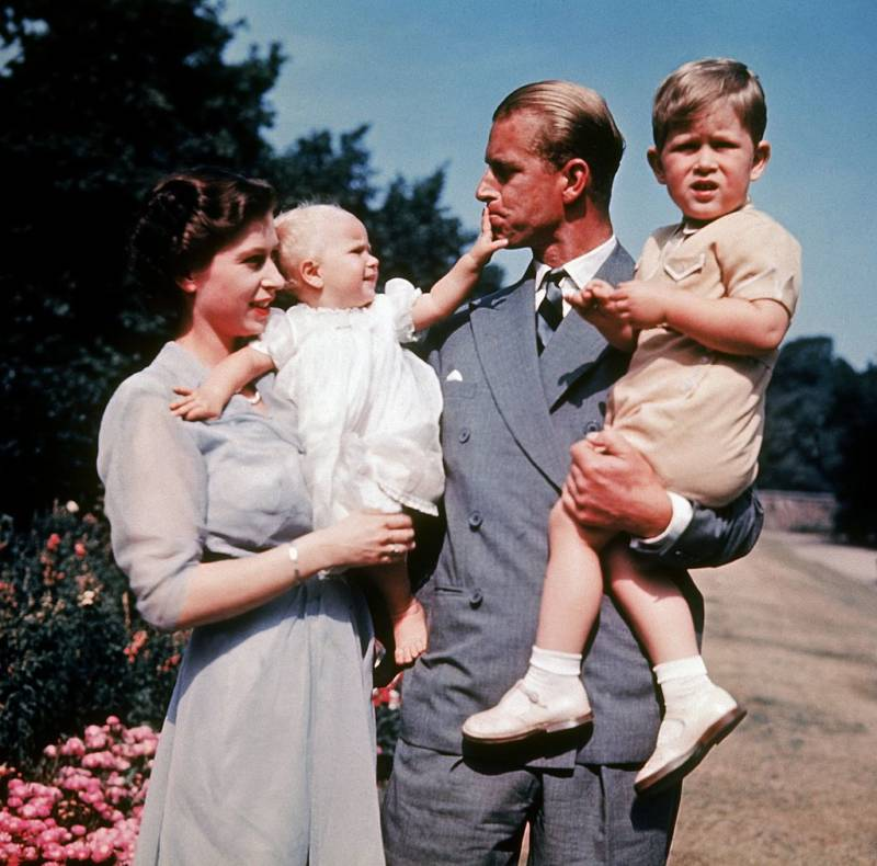 Prince Philip Holding Kids