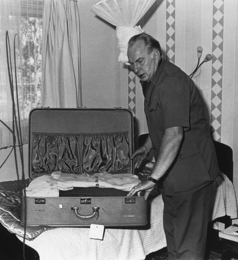 Ron Hubbard Packing Suitcase