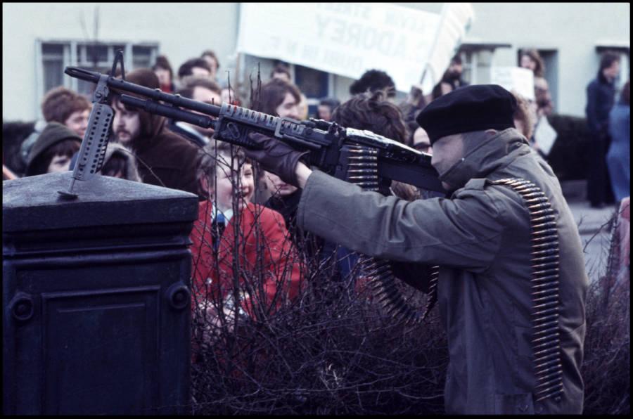 Soldier Holding Large Gun