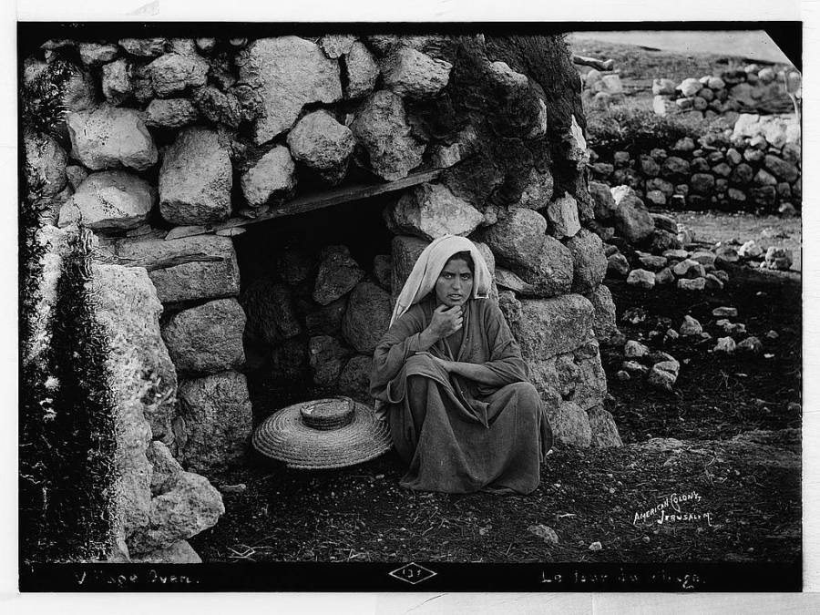 Woman At Village Oven
