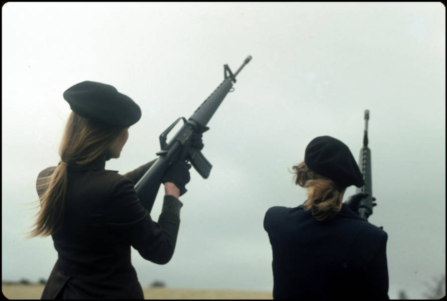 Women Holding Guns