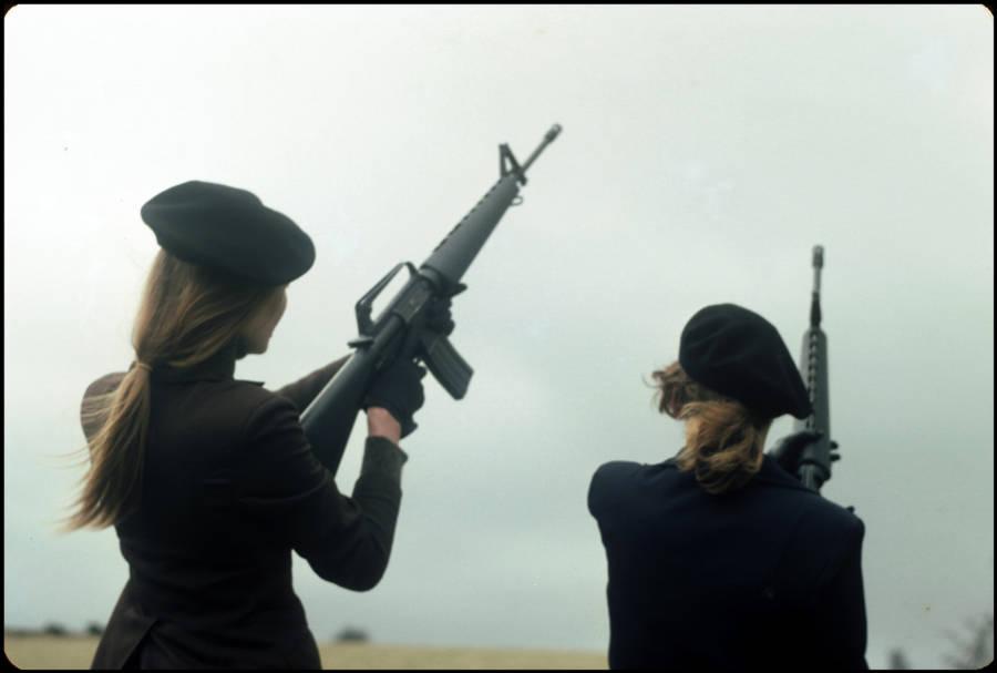 Women Holding Guns