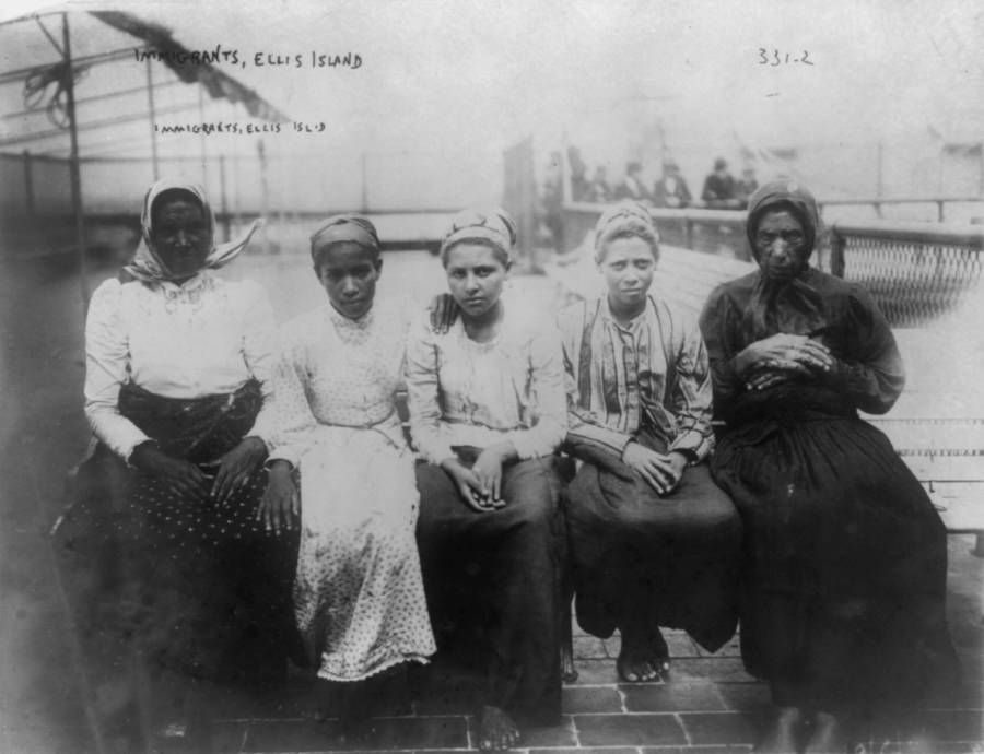 Women Seated In Line