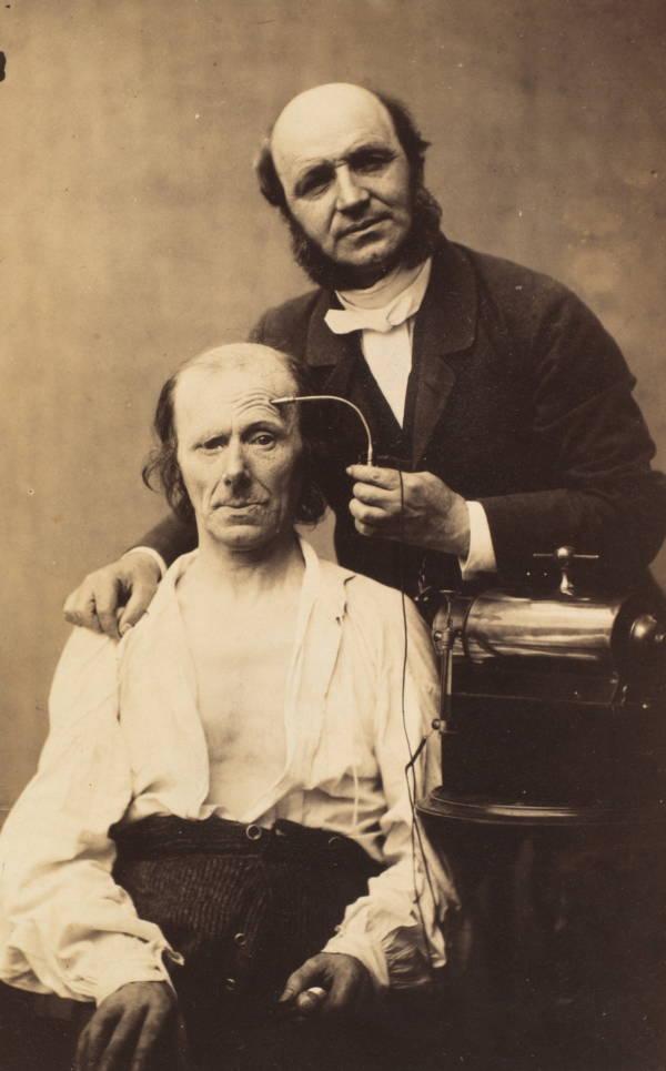 Doctor Standing Beside Subject