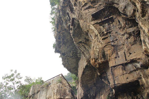 Hanging Coffins On A Mountain In China