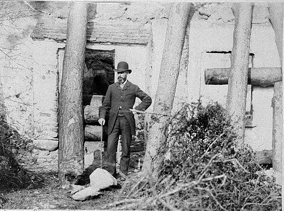 Man Standing Before House