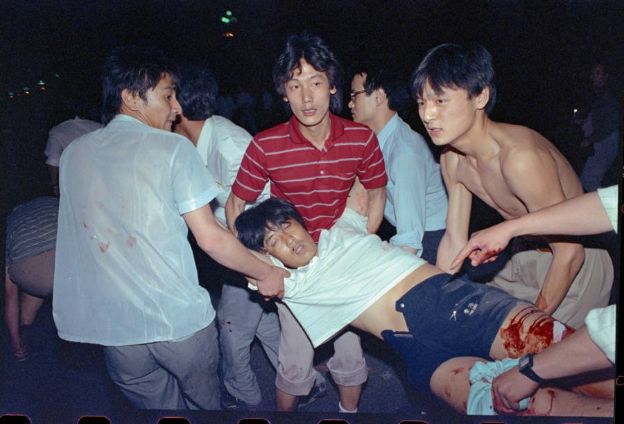Men Carry Wounded Protester