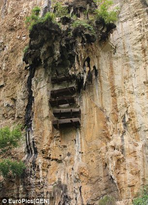 Coffins Hanging Off A Mountain