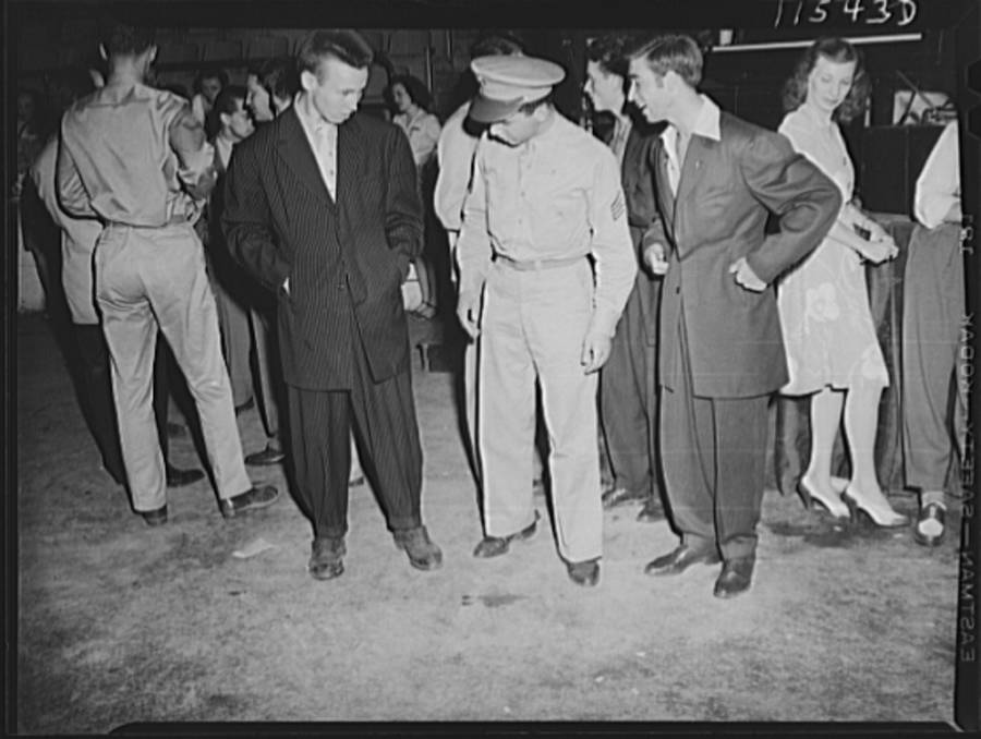 Soldier Inspecting Zoot Suits