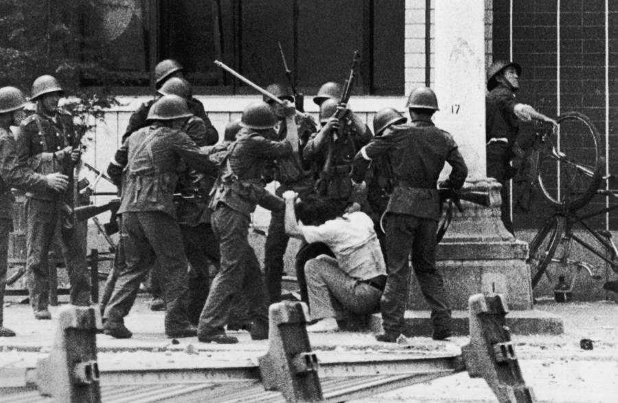 Soldiers Beating Demonstator